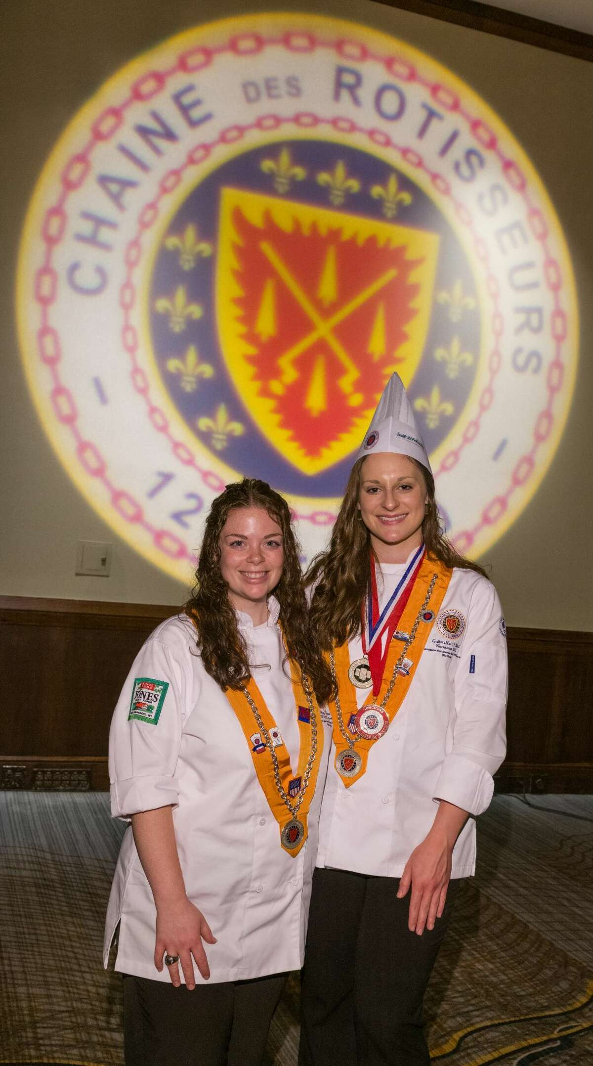Gabriella O'Neil of Albany, right, won the Young Chef National Competition on June 5, 2021, in Kansas City, Mo. The cook-off is sponsored by the Chaine des Rotisseurs, the oldest culinary organization in the world. As the winner, she will represent the United State in the Chaine's global competition for chefs younger than 27, being held in Paris in September 2021. Also competing for the U.S. in September will be Carly Yezzo of Glenville, left, who won the Chaine's American competition in 2019 but was unable to compete in the international event last year because of the coronavirus pandemic. O'Neil, who trains with Yono Purnomo of Yono's restaurant in Albany, where she previously worked, is on the kitchen staff at 15 Church in Saratoga Springs. Yezzo also works in Saratoga, at Hamlet & Ghost. (Provided photo.)