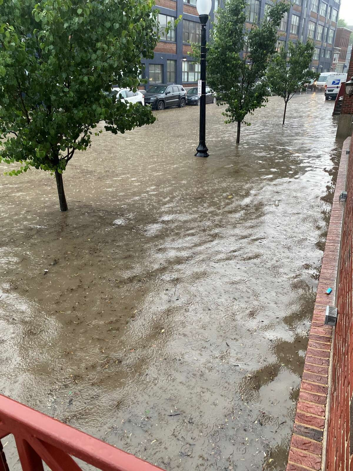 The Sheridan Avenue street and sidewalk in downtown Albany flooded during Tuesday afternoon's rainstorm. The sibling restaurants An American Brasserie and Yono's normally have tables along the sidewalk.