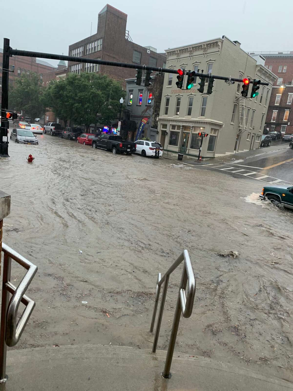 The sidewalk and intersection at the intersection of Chapel Street and Sheridan Avenue in front of Yono's restaurant downtown Albany flooded during Tuesday afternoon's heavy rain.