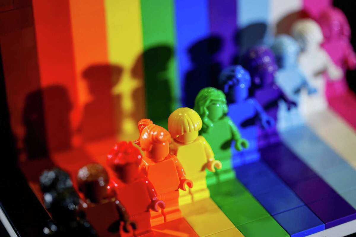 """This picture taken on June 3, 2021 shows Danish toy brick maker Lego's """"Everyone is Awesome"""" new set of rainbow-coloured figurines to celebrate the diversity of its fans and the LGBTQI+ community. / AFP PHOTO / Thomas SAMSON - The new 346-piece set will went on sale on June 1 to coincide with Pride Month, which is dedicated to celebrating the LGBTQI+ communities around the world. (Photo by THOMAS SAMSON / AFP) (Photo by THOMAS SAMSON/AFP via Getty Images)"""