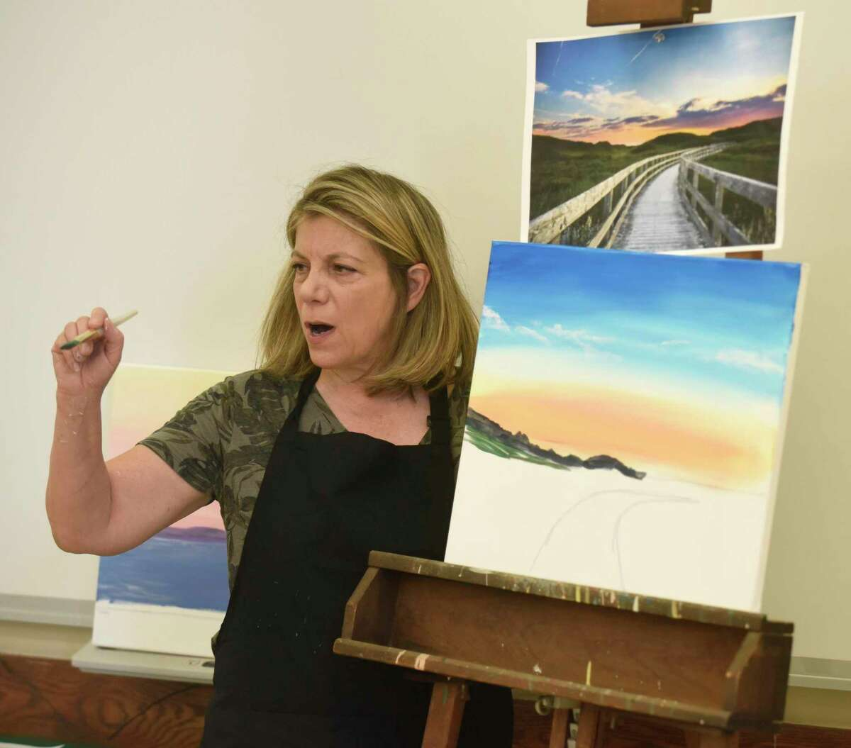 Lorraine Gelard leads a painting class at the Greenwich Senior Center in Greenwich, Conn. Tuesday, June 8, 2021. The painting class, which started last week, is the first on-site, in-person activity available again at the Senior Center since it closed down for COVID more than a year ago.