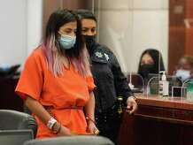 Theresa Balboa is escorted from court after an appearance in the Harris County 180th District Court Monday, June 7, 2021 on a charge of tampering with evidence in connection to the disappearance and presumed death of five-year-old Samuel Olson. State district Judge DaSean Jones reset Theresa Balboa's appearance for a later date. A capital murder investigation is also pending, prosecutors said.