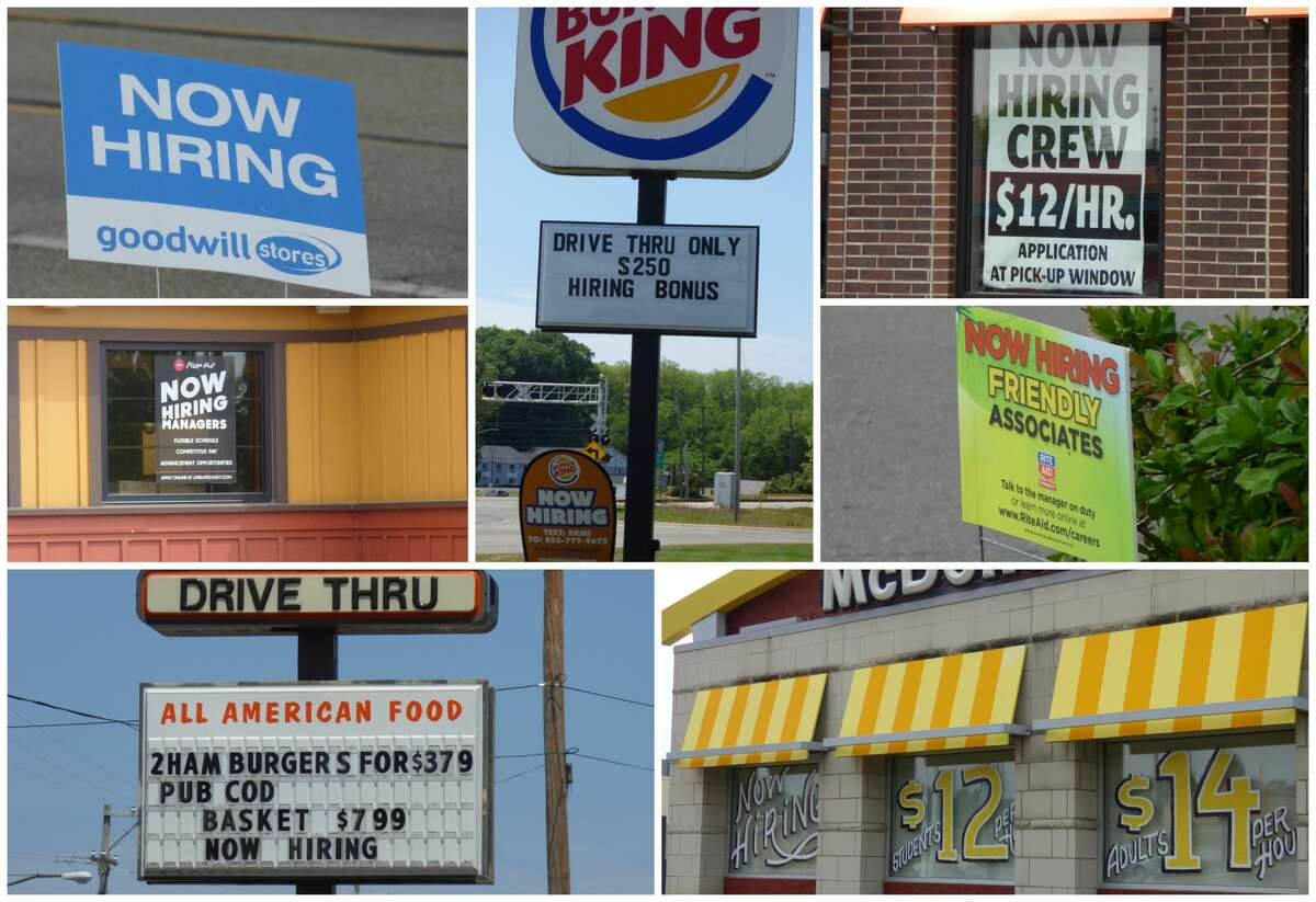 Business along U.S. 31 in Manistee display signs advertising unfilled jobs.