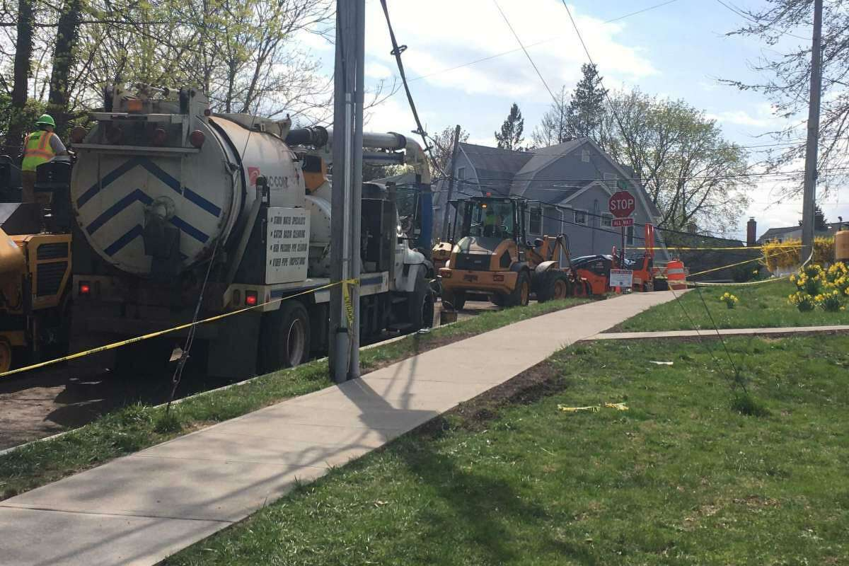 Workers repair a section of pavement on Anderson Road damaged by a major water main break in April.