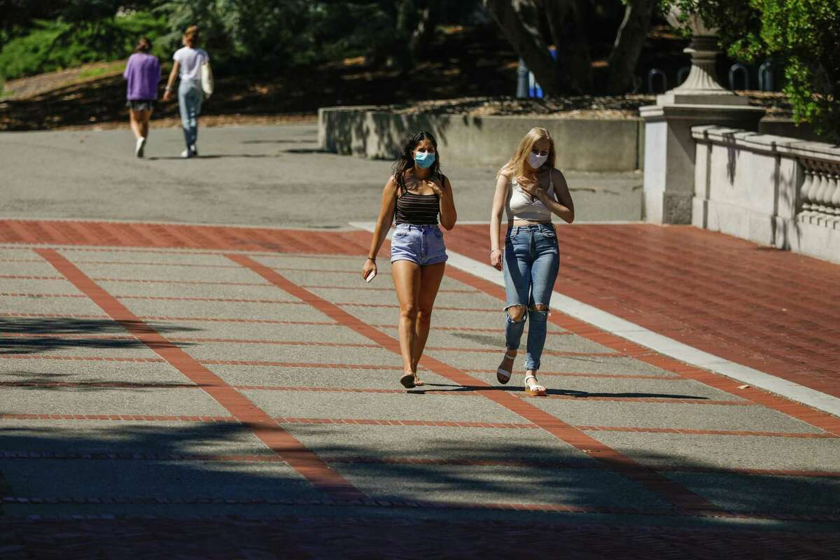 People walk through the UC Berkeley campus last July. The University of California admitted a record number of freshmen and community college transfer applicants this year in its most diverse undergraduate class ever.