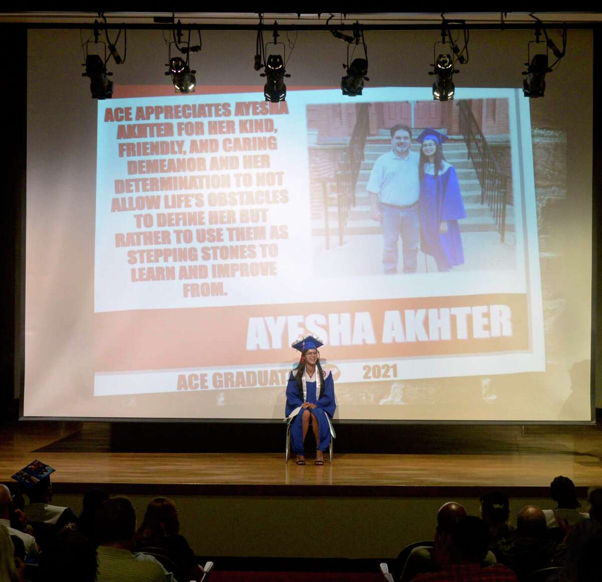 Ayesha Akhter reacts to something her guidance teacher said about her during the Alternative Center for Excellence (ACE) 2021 graduation. Tuesday, June 8, 2021, at Broadview Middle School, Danbury, Conn.