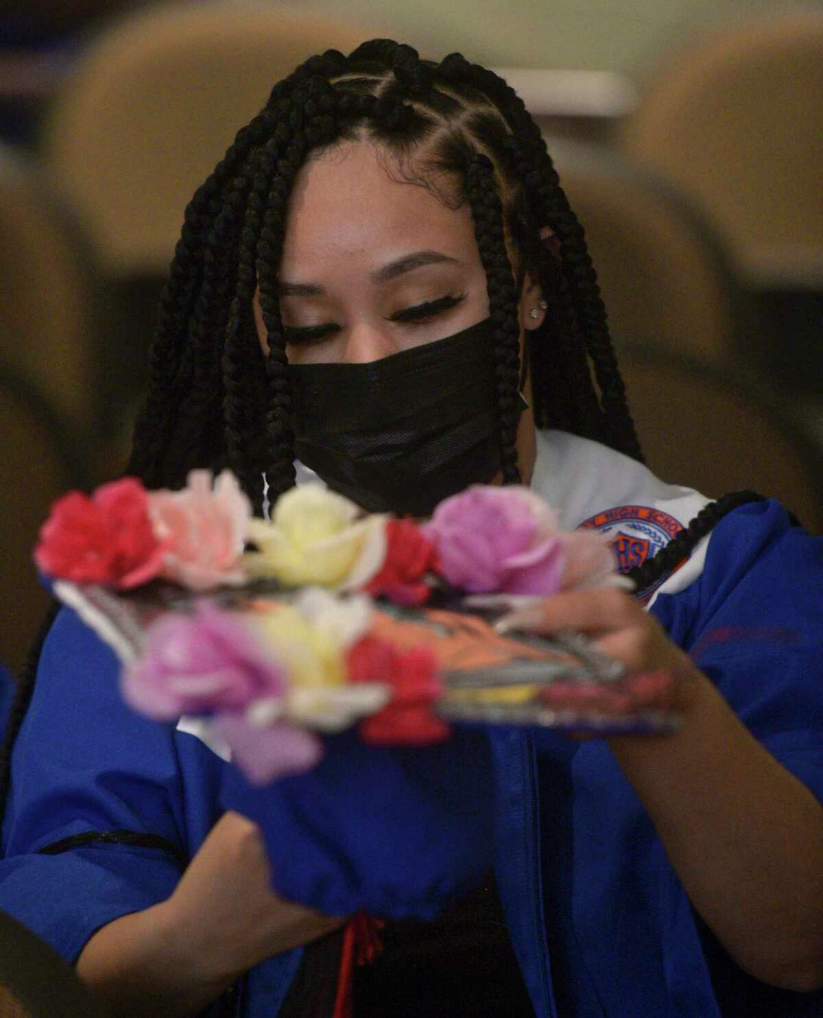 Graduate Aleeya Ruiz attaches a tassel to her cap before the Alternative Center for Excellence (ACE) 2021 graduation. Tuesday, June 8, 2021, at Broadview Middle School, Danbury, Conn.