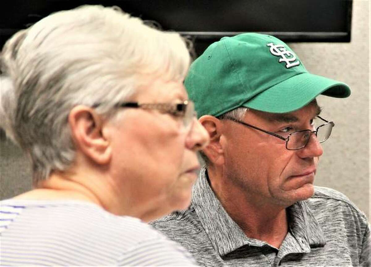 Mike Walters, R-Godfrey, chairman of the Madison County Board's Judiciary Committee, and committee member Liz Dalton, D-Collinsville, listen as people give reports during Friday's committee meeting.