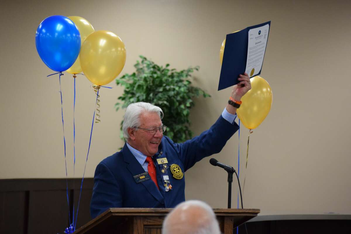 Mayor Charles Starnes, who is a Plainview Rotary Club member and a past Rotary District Governor, shares a proclamation on behalf of the city of Plainview to commemorate the club's 100 years.