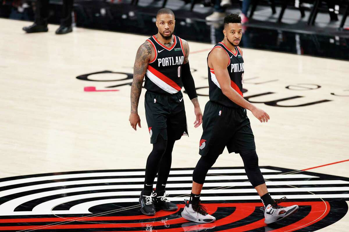 Damian Lillard, left, and CJ McCollum of the Portland Trail Blazers look on in the third quarter against the Denver Nuggets during Round 1, Game 4 of the 2021 NBA Playoffs at Moda Center on May 29, 2021 in Portland, Oregon.
