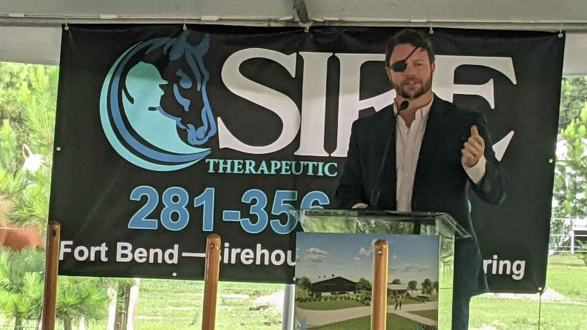 U.S. Rep. Dan Crenshaw speaks at the groundbreaking of SIRE's site expansion, where they provide equine therapy.