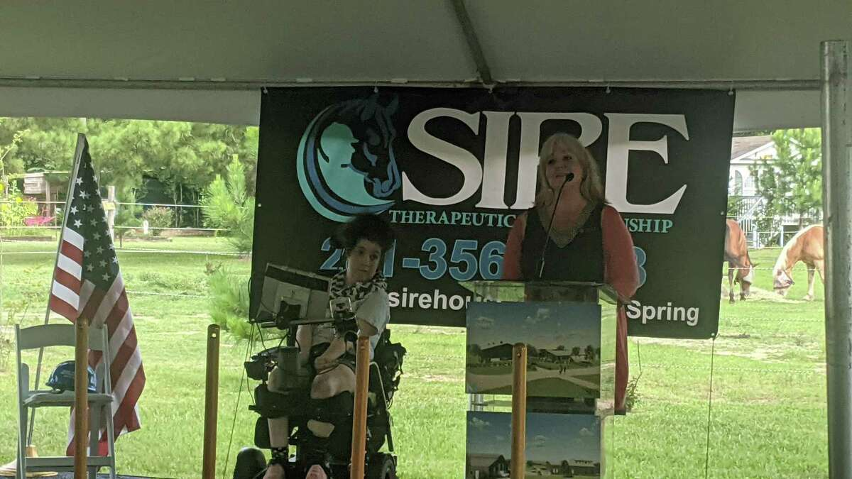 SIRE board members and community members celebrated the groundbreaking of their new site, including Megan Fry, one of their clients, and her mother Andrea Fry