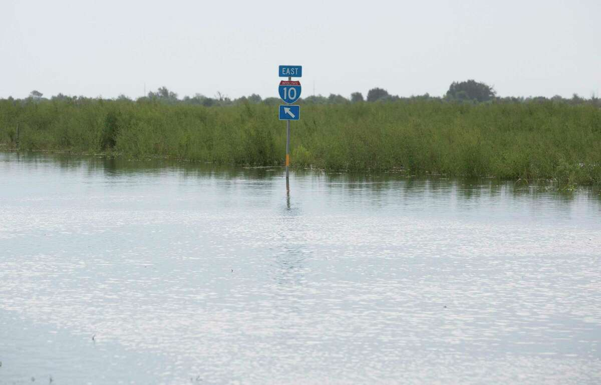 Floodwater from Tropical Depression Imelda pools on the eastbound frontage road of Interstate 10 on Sept. 20, 2019, in Winnie. Local landowners believe the median along the freeway acts as a dam, affecting their properties in heavy rains.