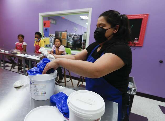 Leslie d'Agrella mixes fondant as she leads a baking class at Over The Top Cake Supplies, Tuesday, June 8, 2021, in Spring. The business offers baking classes for students Tuesday, Wednesday, Thursday and Saturday through the month of July. Photo: Jason Fochtman/Staff Photographer / 2021 © Houston Chronicle