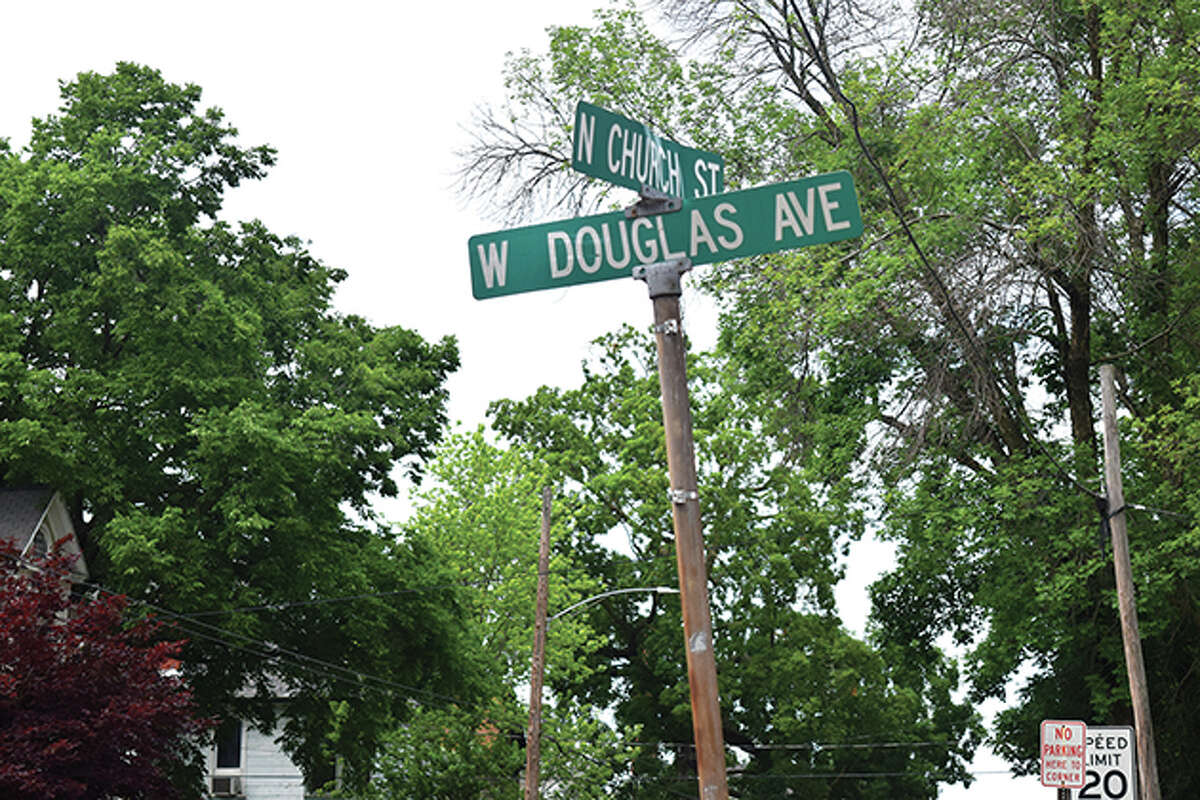 A street sign at North Church Street and West Douglas Avenue was damaged after being hit by a stolen firetruck.