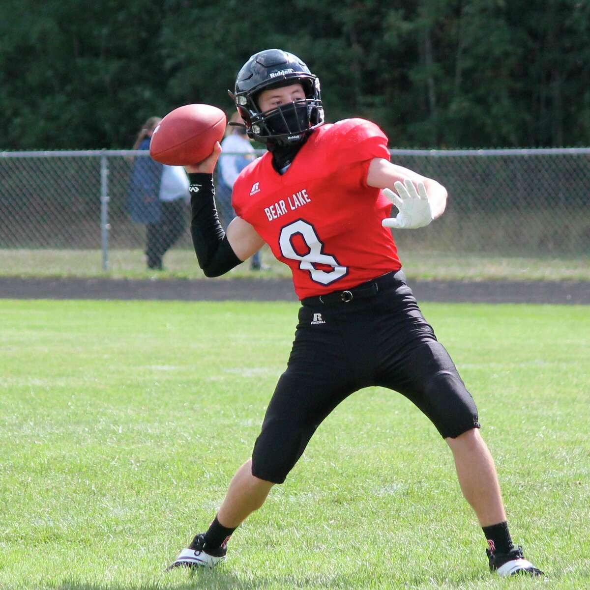 Football players, such as Bear Lake's Tate Aultman (pictured) had to persevere through uncertainty about when and if they would have a season until mid-September. (News Advocate file photo)