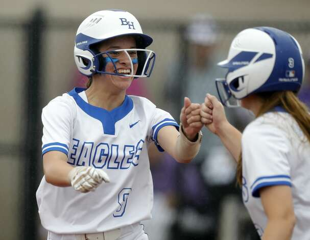 Estela Garza #9 of Barbers Hill gets a fist-bump from Belaney Dunham after hitting a sacrifice-RBI in the first inning of a Class 5A UIL state semifinal game at Leander High School, Friday, June 4, 2021, in Leander. Photo: Jason Fochtman/Staff Photographer / 2021 ? Houston Chronicle