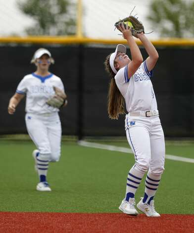 Barbers Hill second baseman Reagan Duty (47) fields a fly ball by Hallsville's Sarah Houston in the fifth inning of a Class 5A UIL state semifinal game at Leander High School, Friday, June 4, 2021, in Leander. Photo: Jason Fochtman/Staff Photographer / 2021 © Houston Chronicle