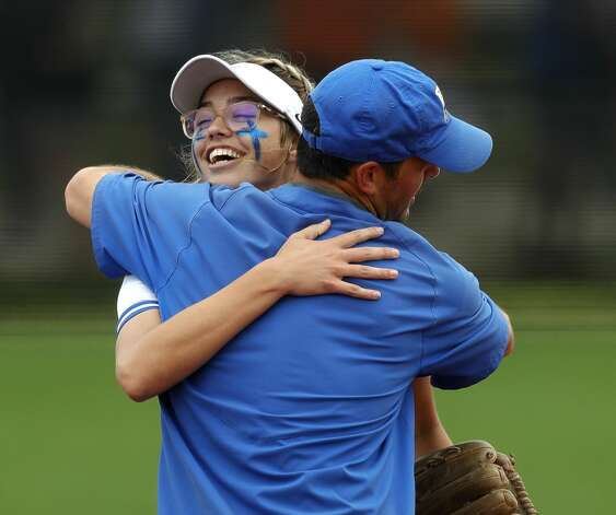 Barbers Hill starting pitcher Samantha Landry (12) celebrates with head coach Aaron Fuller after striking out 12 in the teamÕs 6-0 win over Hallsville to advance to the Class 5A state championship, Friday, June 4, 2021, in Leander. Photo: Jason Fochtman/Staff Photographer / 2021 ? Houston Chronicle