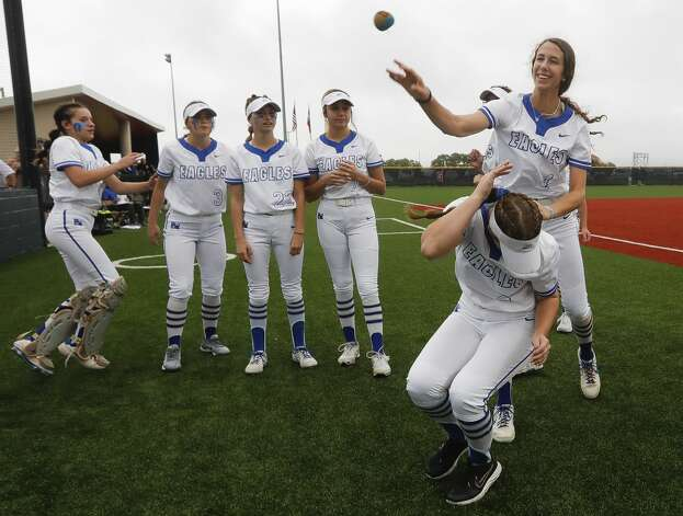 Faith Guidry #4 of Barbers Hill reaches for the hacky sack as players relax before their Class 5A UIL state semifinal game at Leander High School, Friday, June 4, 2021, in Leander. Photo: Jason Fochtman/Staff Photographer / 2021 ? Houston Chronicle