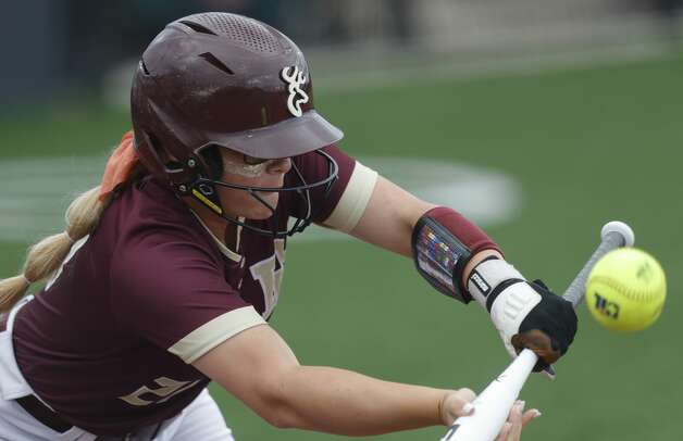 Tabby Bailey #21 of Deer Park bunts the ball in the first inning of a Class 6A state semifinal game, Friday, June 4, 2021, in Leander. Photo: Jason Fochtman/Staff Photographer / 2021 © Houston Chronicle