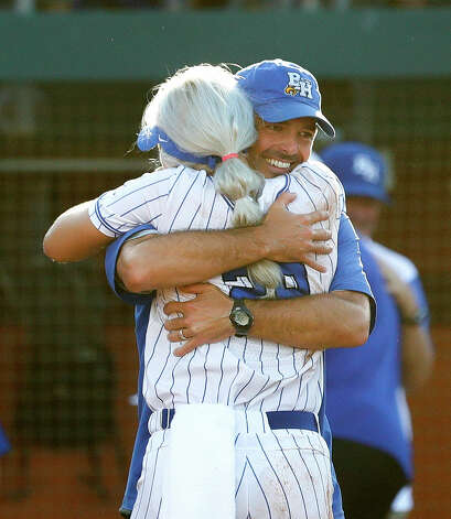 Barbers Hill head coach Aaron Fuller hugs starting pitcher Sophia Simpson after defeating Aledo 4-1 to win the Class 5A UIL state championship at Red & Charline McCombs Field, Saturday, June 5, 2021, in Austin. Photo: Jason Fochtman/Staff Photographer / 2021 ? Houston Chronicle