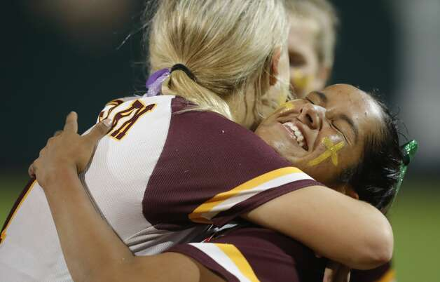 Deer Park starting pitcher Hannah Benavides (7) is embraced by first baseman Haley Wilkerson (11) after being namd MVP after defeating Judson 1-0 to win Class 6A UIL state championship at Red & Charline McCombs Field, Saturday, June 5, 2021, in Austin. Photo: Jason Fochtman/Staff Photographer / 2021 © Houston Chronicle