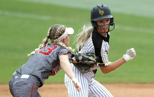 Mikaelah Burkland #10 of Liberty get caught in a rundown with Calallen shortstop Raegan Tennill (33) in the first inning of the Class 4A UIL state championship game at Red & Charline McCombs Field, Saturday, June 5, 2021, in Austin. Photo: Jason Fochtman/Staff Photographer / 2021 ? Houston Chronicle