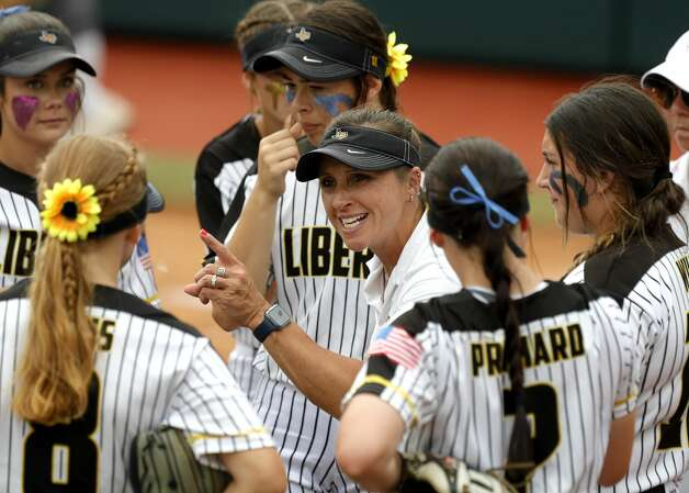 Liberty head coach Karen Slack talks to her team in the second inning of the Class 4A UIL state championship game at Red & Charline McCombs Field, Saturday, June 5, 2021, in Austin. Photo: Jason Fochtman/Staff Photographer / 2021 ? Houston Chronicle