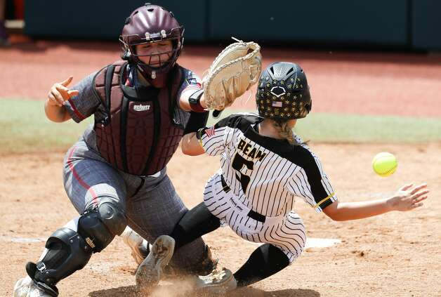 Maci Beam #5 of Liberty beats the throw home to Calallen catcher Lauren Mata (5) to score on Mikaelah BurklandÕs 2-RBI single in the third inning of the Class 4A UIL state championship game at Red & Charline McCombs Field, Saturday, June 5, 2021, in Austin. Photo: Jason Fochtman/Staff Photographer / 2021 ? Houston Chronicle