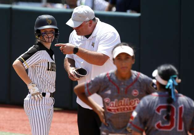 Hollie Thomas #6 of Liberty smiles beside assistant coach Joe Slack after hitting an RBI single in the third inning of the Class 4A UIL state championship game at Red & Charline McCombs Field, Saturday, June 5, 2021, in Austin. Photo: Jason Fochtman/Staff Photographer / 2021 © Houston Chronicle