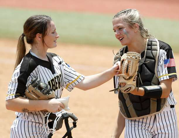 Liberty starting pitcher Kaci West (7) gets a fist-bump from catcher Hollie Thomas (6) in the third inning of the Class 4A UIL state championship game at Red & Charline McCombs Field, Saturday, June 5, 2021, in Austin. Photo: Jason Fochtman/Staff Photographer / 2021 ? Houston Chronicle