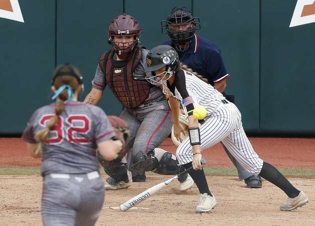 Kylie Bishop #9 of Liberty bunts the ball for a single during the Class 4A UIL state championship at Red & Charline McCombs Field, Saturday, June 5, 2021, in Austin. Photo: Jason Fochtman/Staff Photographer / 2021 ? Houston Chronicle