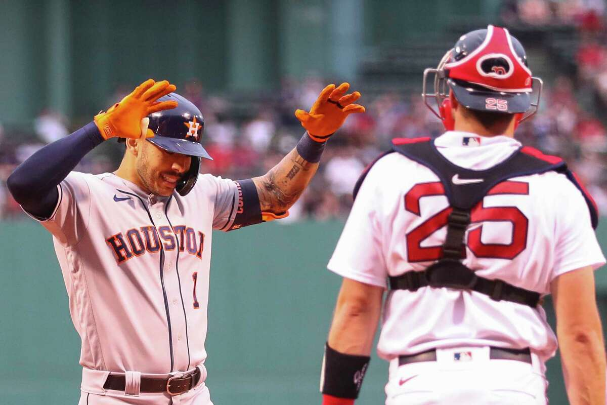 Carlos Correa celebrates his first-inning home run that was upheld by replay and kick-started the Astros' rout of the Red Sox on Tuesday at Fenway Park.