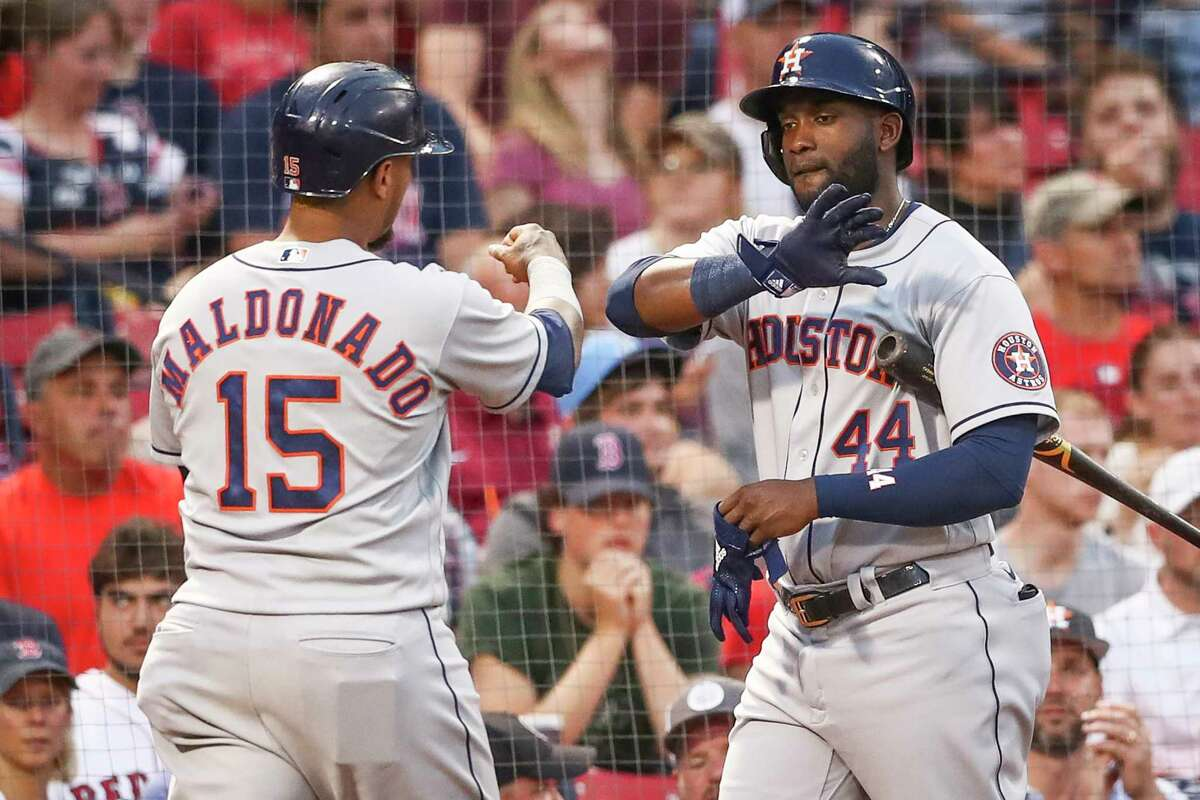 Yordan Alvarez (right) and Martín Maldonado will both be eligible to play Tuesday against the A's after being on the paternity and bereavement list, respectively, during the Astros' most recent series.