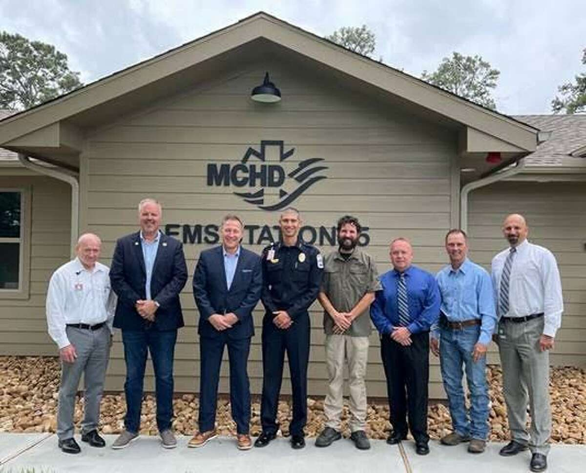 Montgomery County Hospital District EMS Chief James Campbell, standing center, is joined by members of the Conroe City Council and others at the unveiling of the MCHD Station 15 in Conroe.