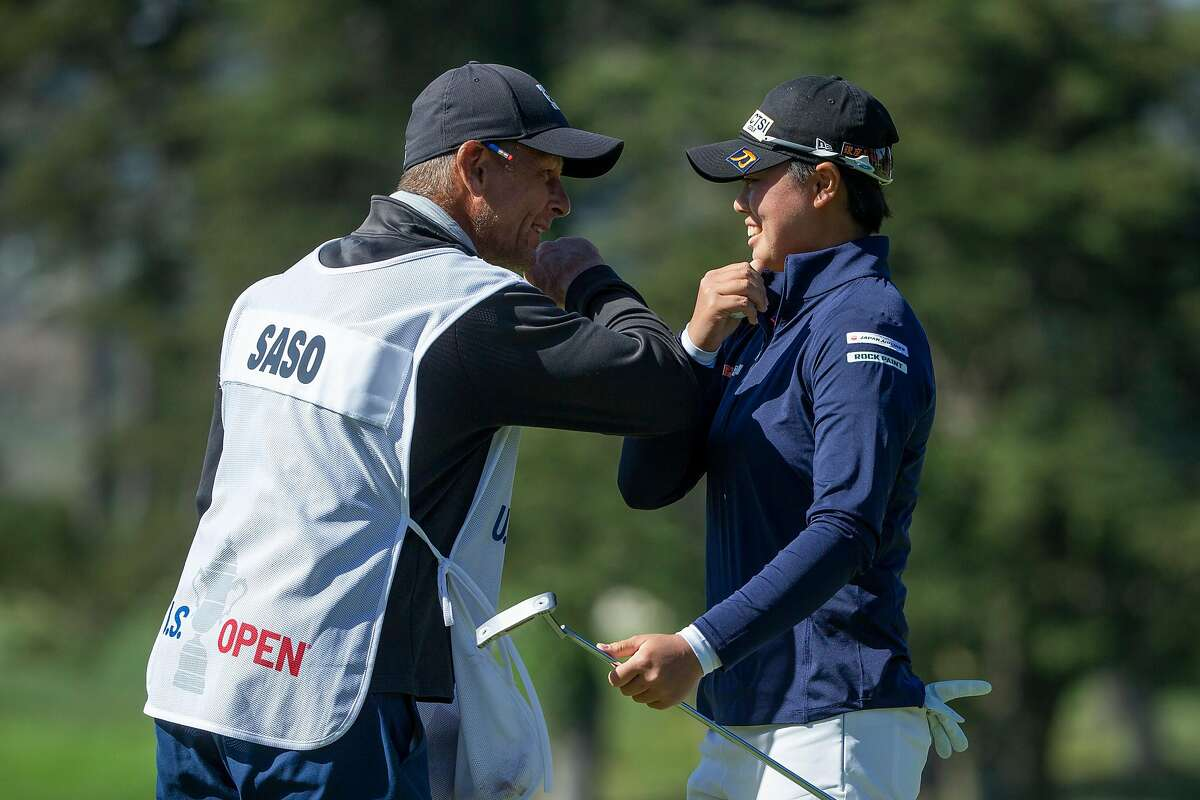 Yuka Saso of the Philippines and her caddie, Lionel Matichuk (left), celebrate after winning the U.S. Women's Open on Sunday. Saso, 19, was one of several young players to impress at the Olympic Club.
