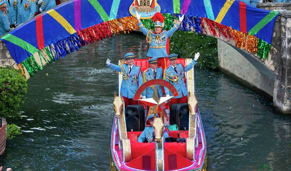 Members of the Texas Cavaliers enter the Arneson River Theatre at La Villita during the Texas Cavaliers River Parade in April 2019. The event is back for Fiesta 2021.