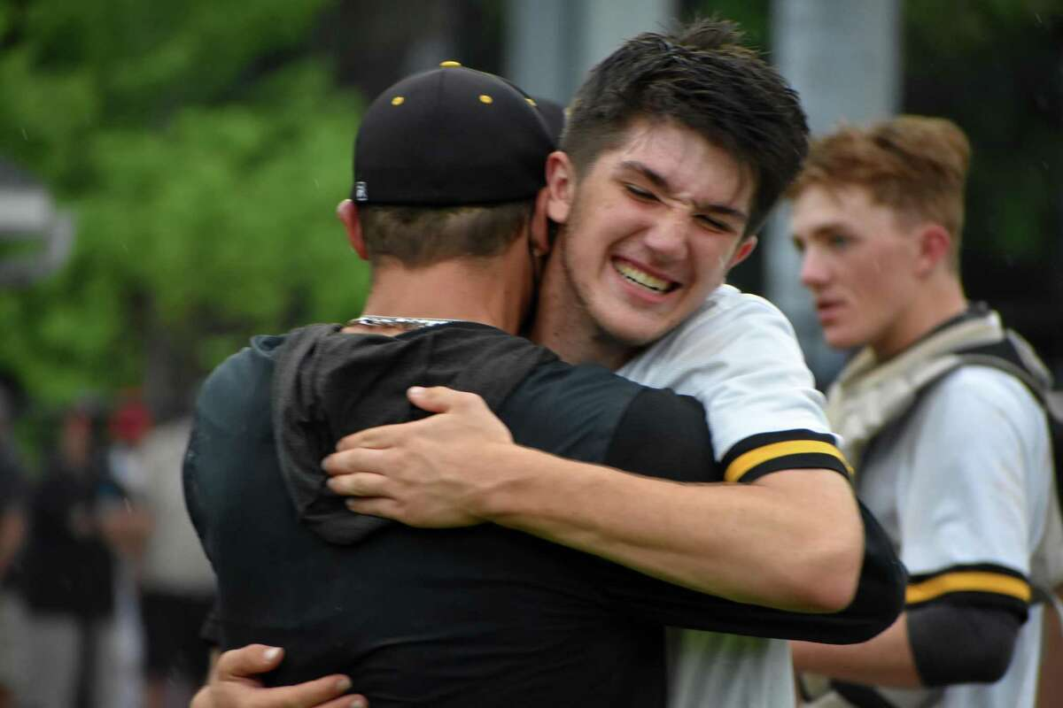 Hand celebrates beating Avon, 2-1, in 10 innings during the Class L baseball semifinals against Avon at Palmer Field in Middletown on Tuesday.