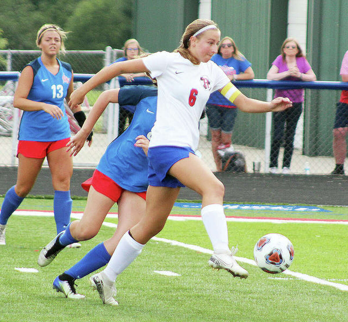 Macie Lucas controls the ball as she heads upfield Tuesday in 1A sectional semifinal action at Carlinville. She scored a goal in her team's 4-0 victory.