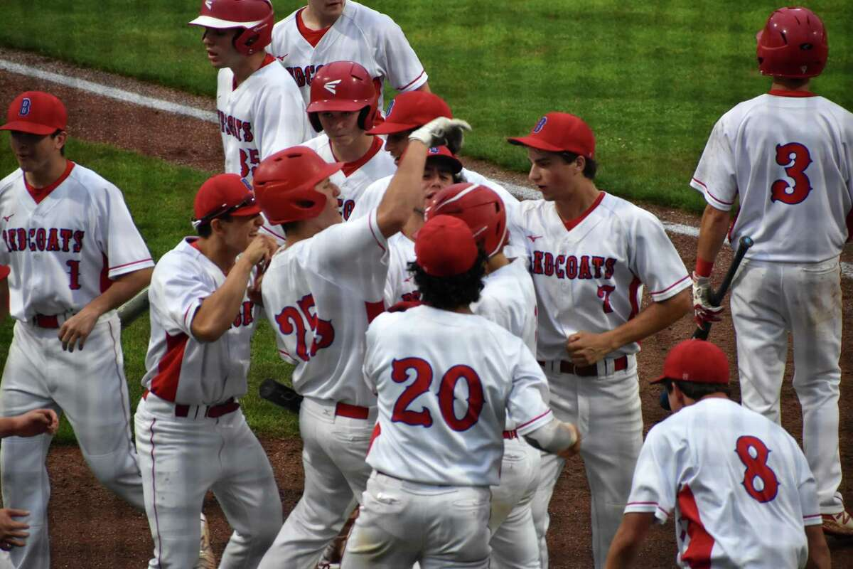 Berlin's Jamie Palamese celebrates with his teammates after hitting a home run in the Class L baseball semifinals at Palmer Field, Middletown on Tuesday, June 8, 2021.