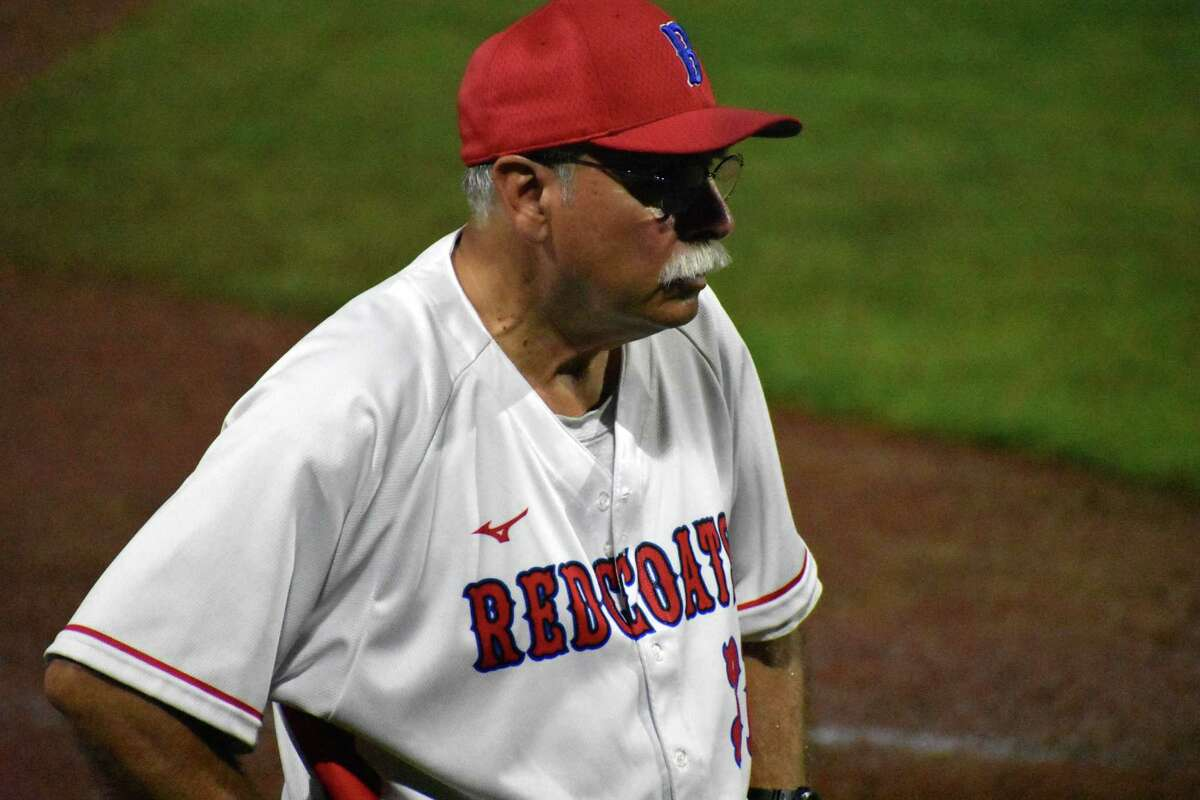 Berlin coach Leo Veleas stands in the third base coaches box in the Class L baseball semifinals at Palmer Field, Middletown on Tuesday, June 8, 2021.