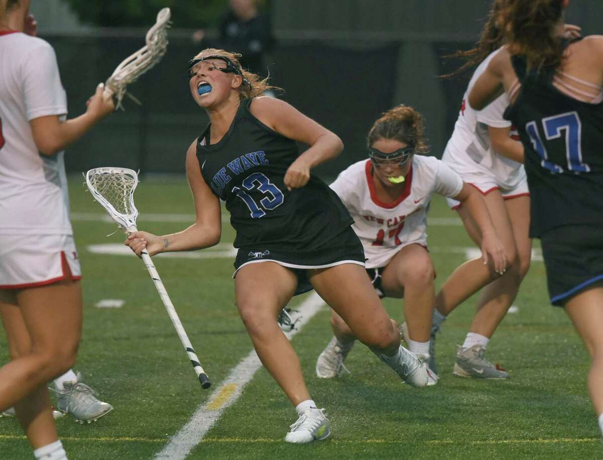 Darien's Molly McGuckin (13) celebrates a second-half goal during the Wave's win over New Canaan in the CIAC Class L girls lacrosse semifinals at Dunning Field on Tuesday, June 8, 2021.