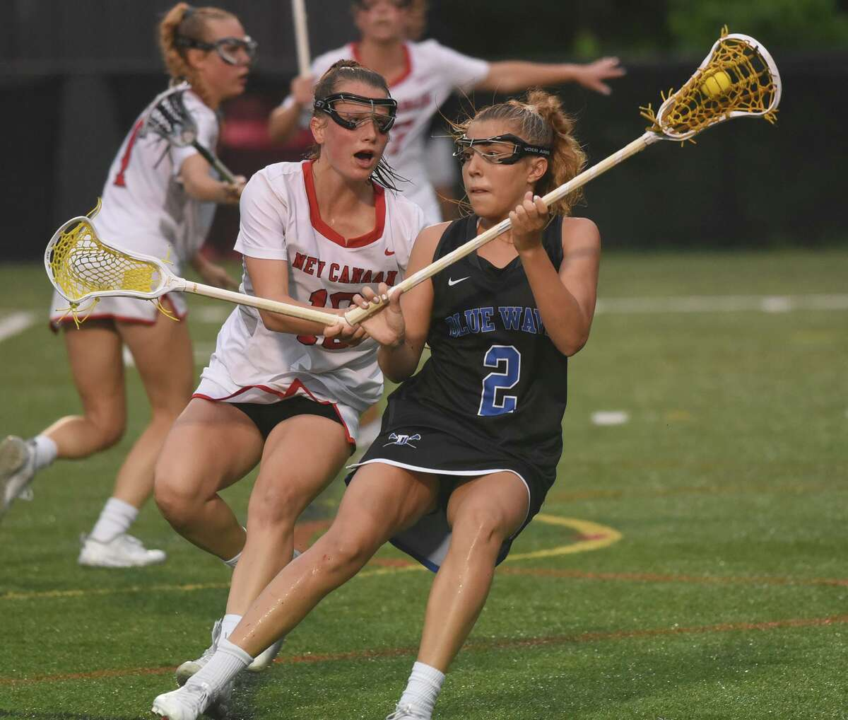 Darien's Chloe Humphrey (2) controls the ball while New Canaan's Jade Lowe (10) defends during a CIAC Class L girls lacrosse semifinal game at Dunning Field on Tuesday, June 8, 2021.