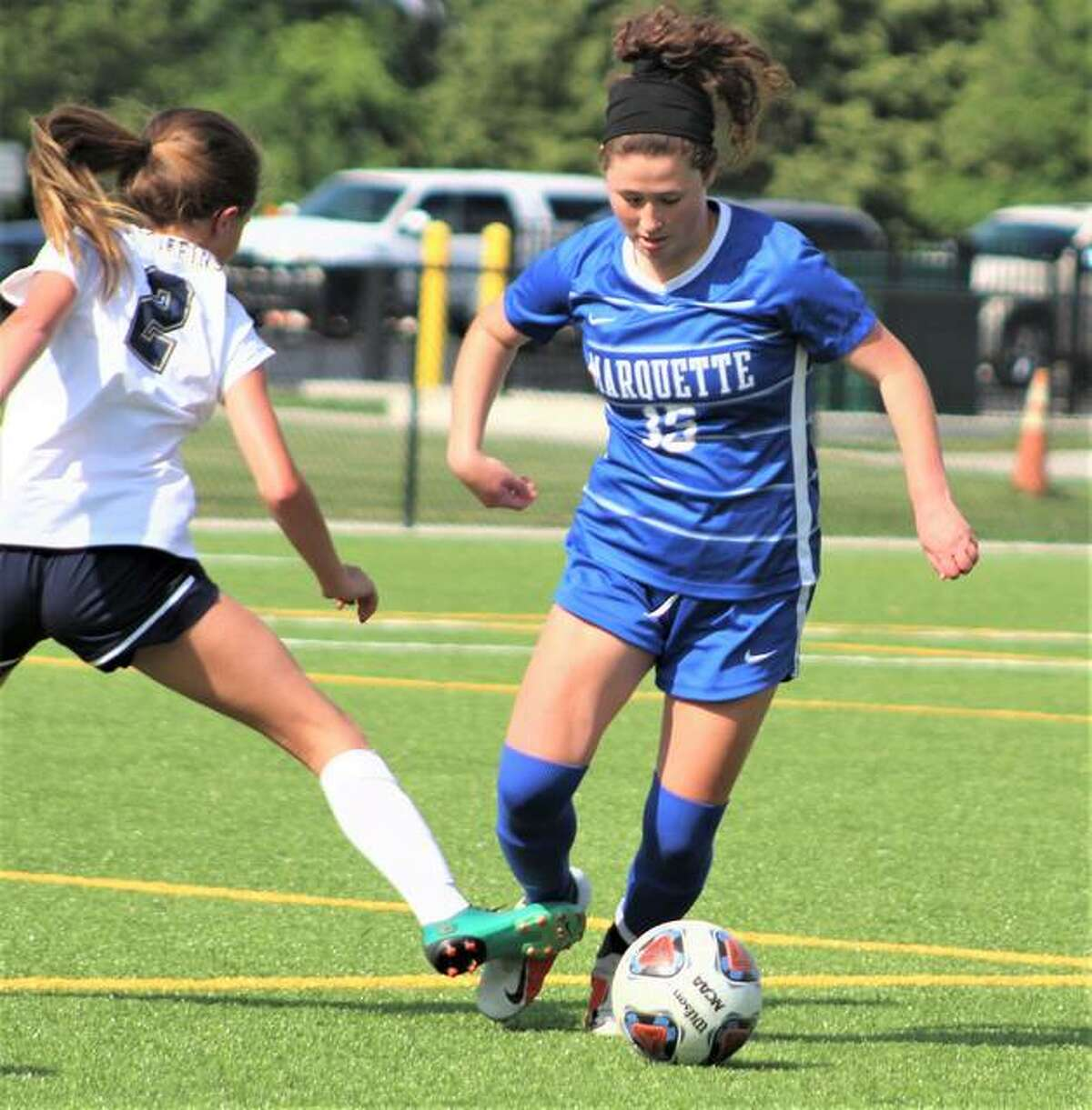 Marquette's Madelyn Smith (15) scored a goal and added three assists Tuesday night in the Explorers' 9-0 Class 1A sectional tournament semifinal win over Litchfield at Gordon Moore Park.