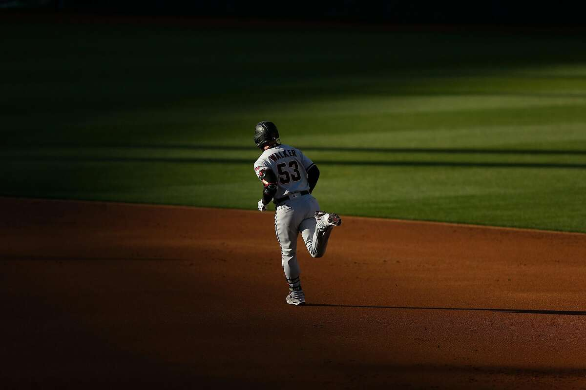 OAKLAND, CALIFORNIA - JUNE 08: Christian Walker #53 of the Arizona Diamondbacks rounds the bases after hitting a solo home run in the top of the second inning against the Oakland Athletics at RingCentral Coliseum on June 08, 2021 in Oakland, California. (Photo by Lachlan Cunningham/Getty Images)