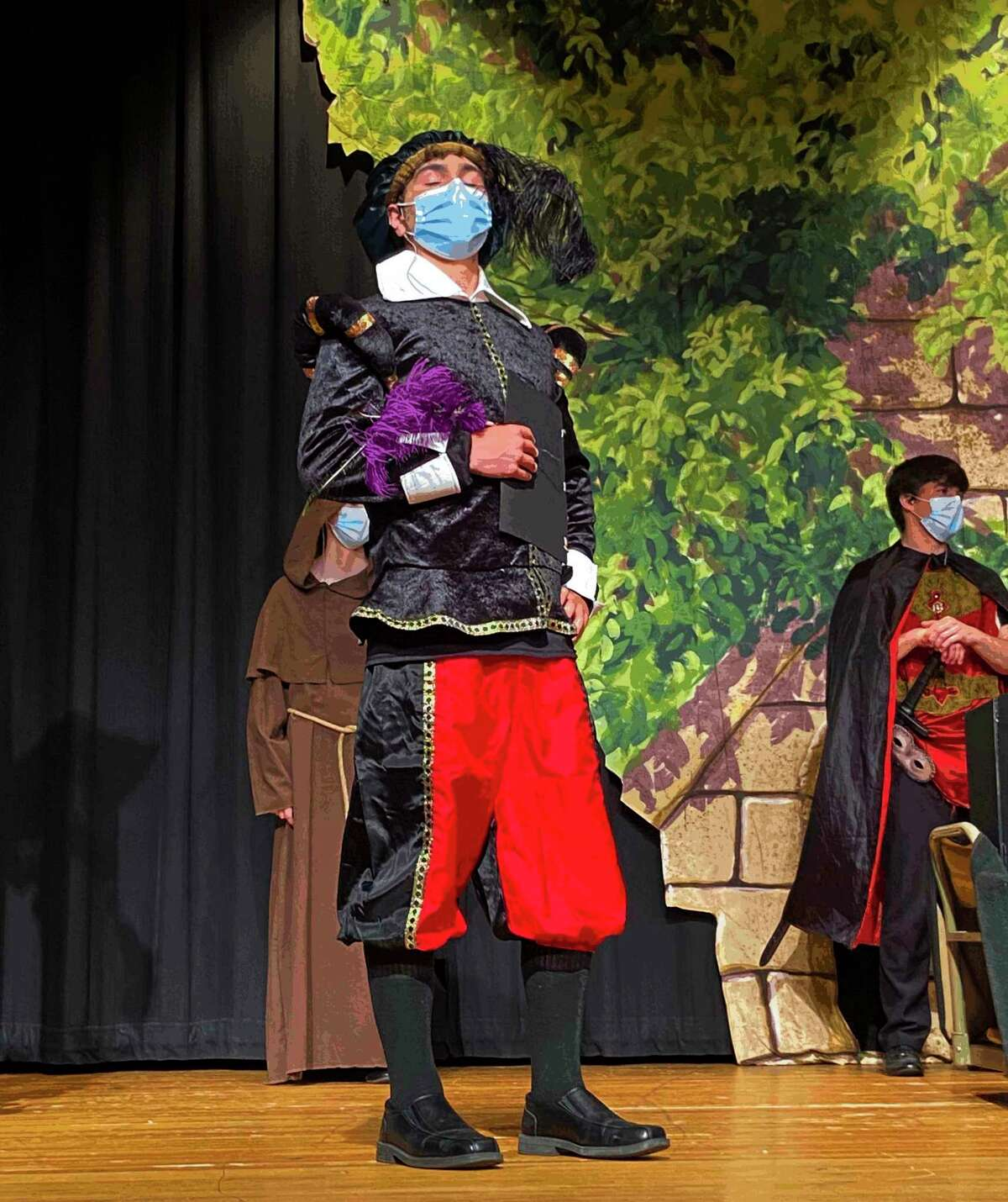 Senior Dylan Crandall, in the role of Shakespeare, performs during Coleman High School's production of the comedy