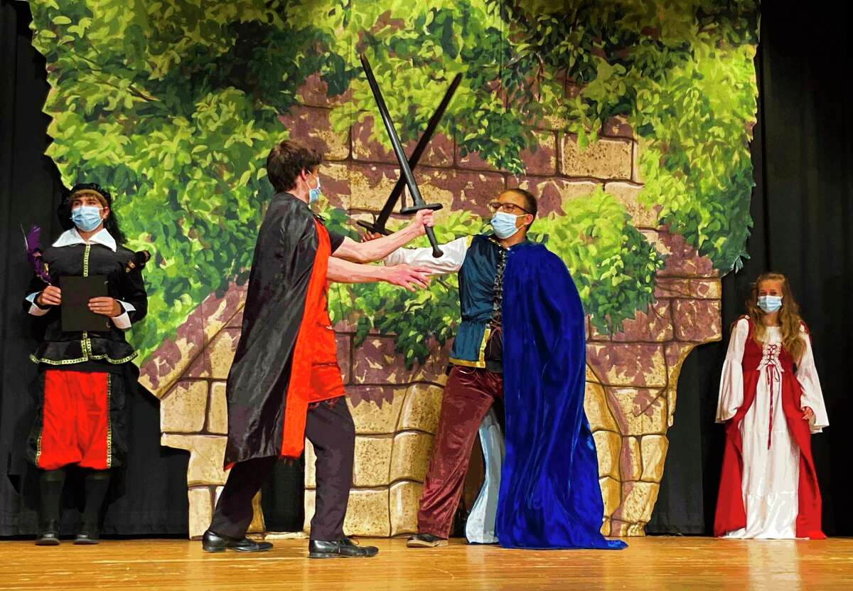 Alumnus Austin Lumbert, left, and Marlon Garcia, right, perform during Coleman High School's production of the comedy