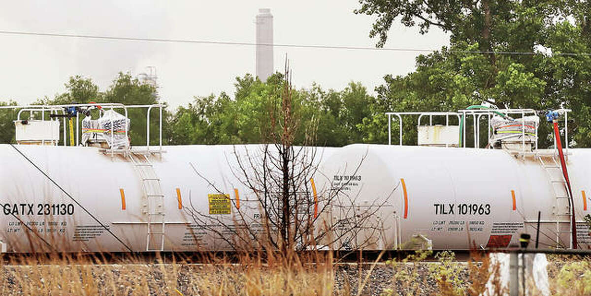 Two of the four railroad cars located about halfway between Wood River and Hartdford were sealed in plastic Tuesday morning as part of a containment system now in place. Late Tuesday night officials reported the other two railcars also had been sealed, and all four had been safely moved back to the Phillips 66 refinery.