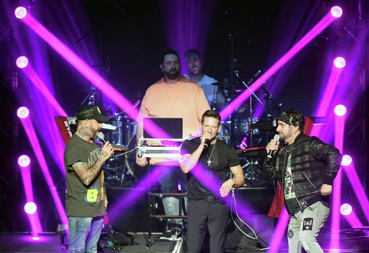 LAS VEGAS, NEVADA - JUNE 05: (L-R) Recording artist AJ McLean of the Backstreet Boys, DJ Lux, recording artist Jeff Timmons of 98 Degrees and recording artist Chris Kirkpatrick of 'N Sync perform during